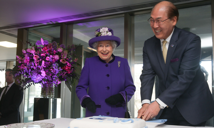 Purple reign! Queen Elizabeth flashed a cheeky smile as she watched the Secretary-General of the International Maritime Organization, Kitack Lim cut a cake on March 6. The monarch was on hand to celebrate the 70th anniversary of the organization's formation.