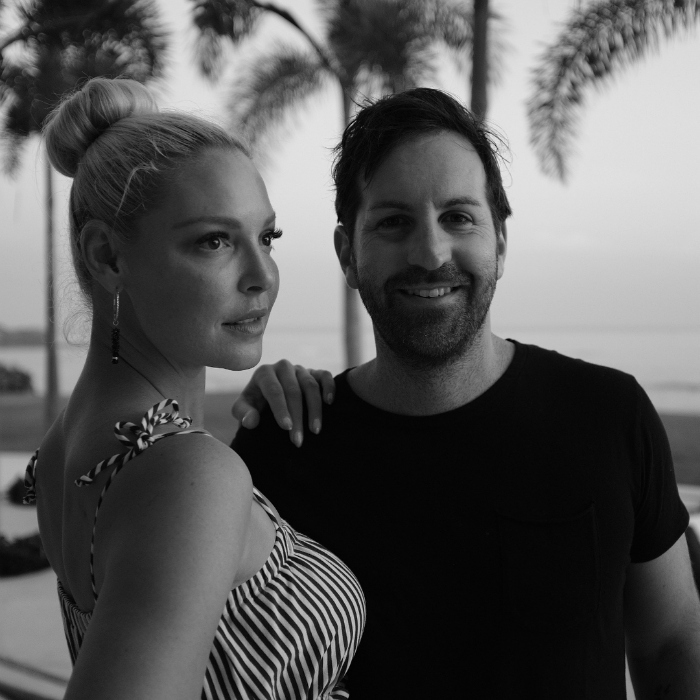 """Mis Amores..."" Katherine wrote alongside more photos. The first of which was a nice black-and-white shot of Mom and dad amid palm trees.
