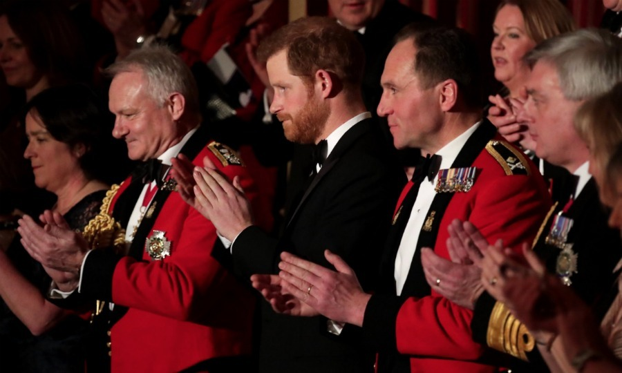 Flying sans Meghan Markle, the 33-year-old seemed to enjoy the evening of music. The annual event features military musicians from the Royal Marines showcasing a range of musical styles in a West End-worthy spectacular. 