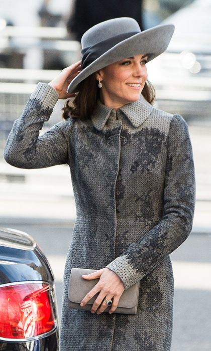 Kate accessorized the late winter outfit with a grey John Boyd hat, drop earrings and a suede clutch in a matching hue.