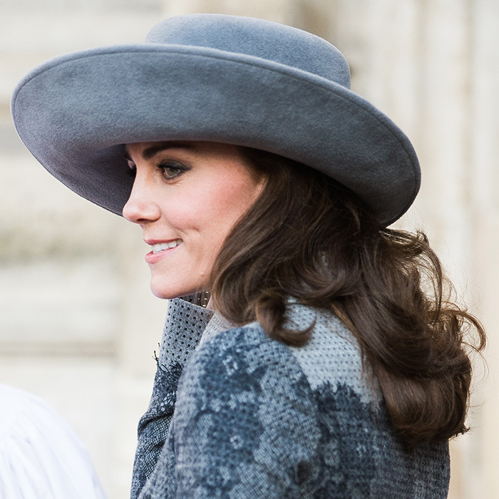 Underneath the John Boyd hat, Duchess Kate wore her hair in full, loose curls that cascaded down her back.