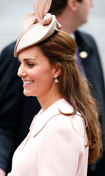 Duchess Kate wore her her hair in a half updo, not unlike the style she wore for her 2011 wedding day with Prince William. The finishing touch of the outfit was a pretty Jane Taylor hat. 