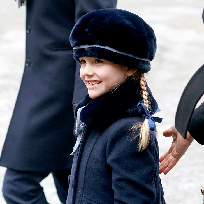 Princess Estelle, who is second in line to be Queen behind her mom Princess Victoria, was adorable with her hair in braids and wearing a navy blue outfit matching her parents' look. 