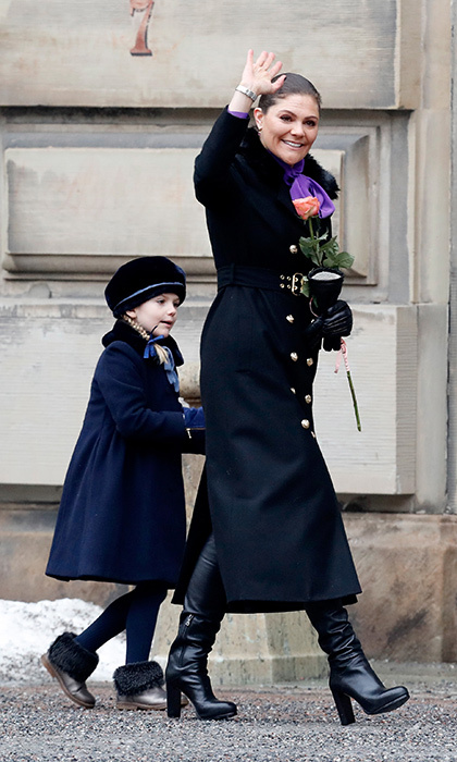Princess Estelle seemed to be keeping an eye on Crown Princess Victoria's actions to get a grasp of royal protocol as they braved the frosty weather and waved to the crowds outside.