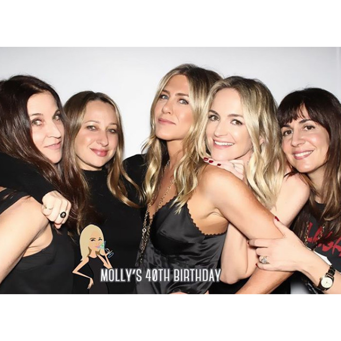 Jennifer Aniston was in great spirits celebrating Jimmy Kimmel's wife's birthday on Monday. Looking chic in a scalloped black camisole with gold jewelry, the actress posed for photos with a gaggle of girlfriends as they toasted  Molly McNearney's 40th birthday. 