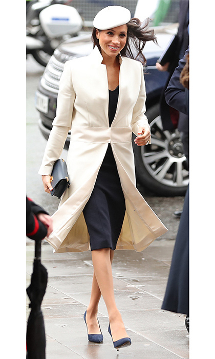 Meghan Markle wore a tailored navy dress and a white coat by Amanda Wakeley with navy blue Manolo Blahnik pumps to the Commonwealth Service, topping the look with a chic white beret by Stephen Jones.