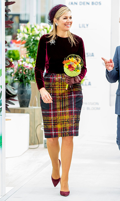 Queen Maxima of the Netherlands also showed she's mad for plaid in a patterned pencil skirt worn with a deep burgundy velvet top. The royal was visiting the opening of the World Horti Center, the international knowledge and innovation center for greenhouse horticulture in Naaldwijk, Netherlands. 