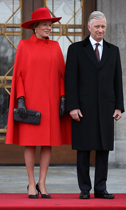 Visiting Canada with husband King Philippe, Queen Mathilde of Belgium paid tribute to her host country's flag with a bright red cape and matching hat. 