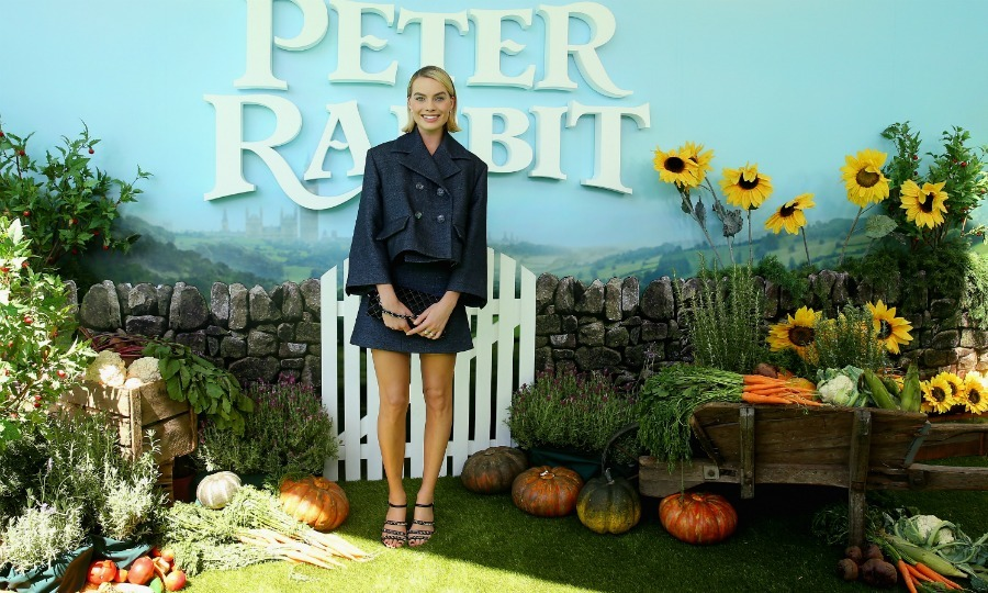 Margot Robbie opted for a Chanel ensemble as she walked the green grass carpet on St. Patrick's Day. The 27-year-old Oscar nominee went back to her native land of Australia to premiere her new movie <i>Peter Rabbit</i>.