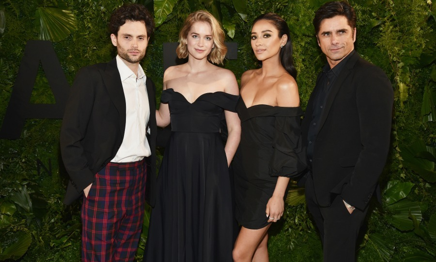 "Penn Badgley, Elizabeth Lail, Shay Mitchell, and John Stamos stepped out for the 2018 A+E Upfront on March 15 in New York City. ""We put on our dressy clothes to celebrate our new show, 'YOU', premiering on @lifetimetv SEPTEMBER 9th!"" Shay Mitchell wrote on Instagram. ""Can't wait for YOU all to see! # #whatwasJohnlookingat ?!""