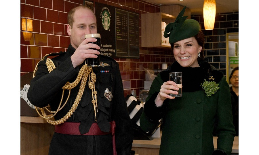 Pregnant Kate Middleton sipped on water while husband Prince William enjoyed a pint of Guinness at the Cavalry Barracks for the annual Irish Guards St. Patrick's Day Parade in Hounslow, England.