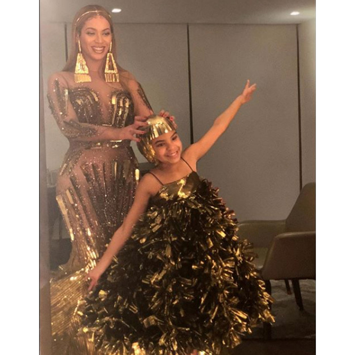 Golden girls! Beyonce and Blue Ivy coordinated their looks for the Wearable Art Gala in L.A. on March 17. The ladies were accompanied by Jay-Z to the event founded by the <i>Bonnie and Clyde</i> singer's mother Tina Lawson. 