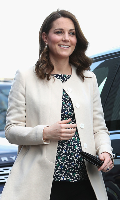 Stepping out on March 22, and making her second stylish appearance of the week, the Duchess of Cambridge stunned the waiting crowd at London's Olympic Park, wearing a $850 cream coat by Goat, black high heel shoes, a simple clutch bag by Mulberry, black trousers and a $69 top by Hobbs. The pregnant royal wore her hair loose in her trademark curled style and sported a fresh glow, showing off her natural beauty with minimal makeup. Kate was joined by her husband Prince William – and their first port of call was the Copper Box which is in aid of SportsAid. The charity helps young British sportsmen and women aspire to be Britain's next Olympic, Paralympic, Commonwealth and world champions.