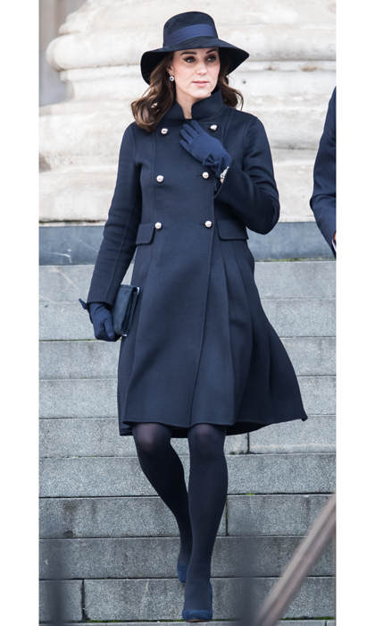The Duchess of Cambridge opted for a demure ensemble for the Grenfell Tower national memorial service on December 14. Kate kept her baby bump under wraps wearing a double breasted double-faced wool coat by Carolina Herrera. The Duke's wife accessorized the navy coat with matching accessories including a wide-brimmed hat, gloves, tights and her Jimmy Choo Georgia shoes. 