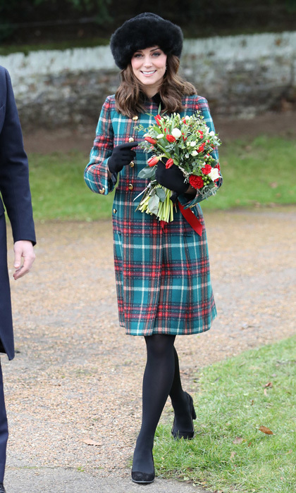 Kate Middleton looked festive wearing a red and green Miu Miu velvet-trimmed double-breasted tartan wool-blend peacoat for Christmas Day church service at St . Mary Magdalene Church with the royal family. The Duchess accessorized her holiday look with a warm black hat, her TOD's black suede pumps, a Mulberry clutch and Cornelia James gloves.