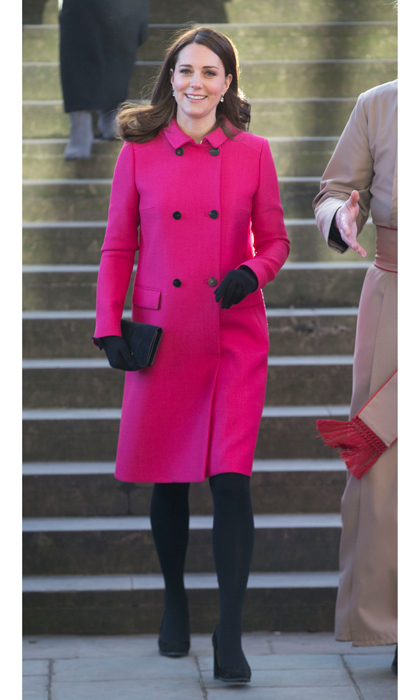 Kate Middleton made a colorful splash recycling her cerise pink Mulberry coat — that she debuted in 2014 during her trip to New York — on January 16 for her and Prince William's visit to Coventry, England. The Duchess completed her look with black tights, her suede TOD's pumps, a suede Mulberry clutch and black gloves. The pregnant royal, who is due in April, looked flawless as she greeted the staff, with her brunette locks styled to perfection. Her natural beauty was enhanced with barely-there make-up, including foundation, nude lipstick and brown eye make-up. 