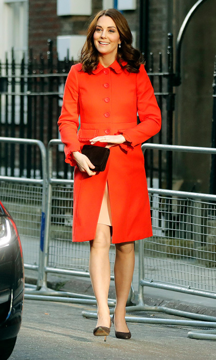 The Duchess of Cambridge was the lady in red for her first engagement of the day on January 17. Kate visited the Mittal Children's Medical Centre in London wearing a peach dress beneath her structured Boden coat that featured ruffles at the collar and sleeves. The expectant royal teamed the vibrant piece with her Annoushka Baroque Pearl Drops, an Emmy Natasha clutch and brown pumps.  