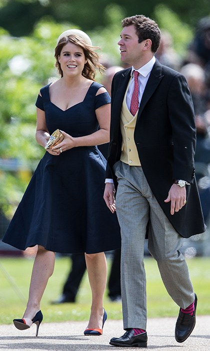 "Joined by her future husband Jack Brooksbank, Eugenie wore a dark blue dress with cut-out shoulders, along with color block shoes, to <a href=""https://us.hellomagazine.com/weddings/12017052022644/pippa-middleton-james-matthews-wedding-arrivals-highlights/1/""><strong>the wedding of Pippa Middleton and James Matthews</strong></a> in May 2017.