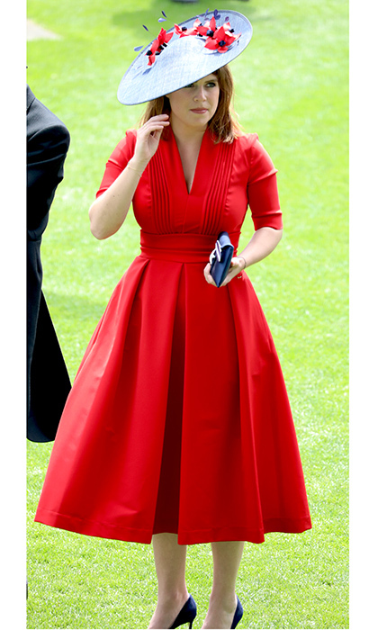 The Princess looked elegant in a tailored red dress and blue hat with scarlet flower details on Ladies Day of Royal Ascot 2017 at England's Ascot Racecourse in June 2017.