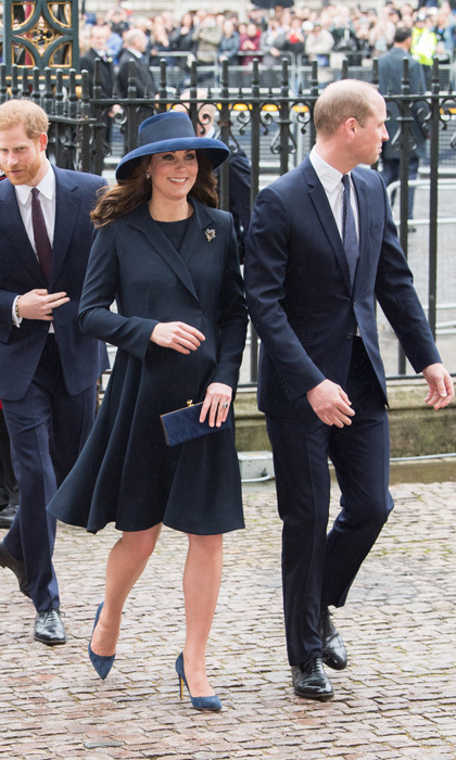 Bumpin' in blue! Kate dressed for the occasion during the Commonwealth Service at the Westminster Abbey in a coat by Beulah London paired with her trusted navy heel from Rupert Sanderson. The Duchess topped off her look with a matching hat by Lock and Co.
