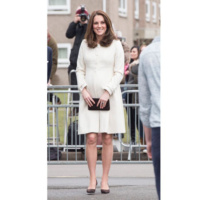 Kate was a vision in white as she recycled one of her classic maternity looks. The soon to be mommy-of-three wore a white Jojo Maman Bébé coat during her visit to the Pegasus Primary School on March 6. The ever-stylish Duchess wore the coat for the first time when she was pregnant with Princess Charlotte in March 2015.