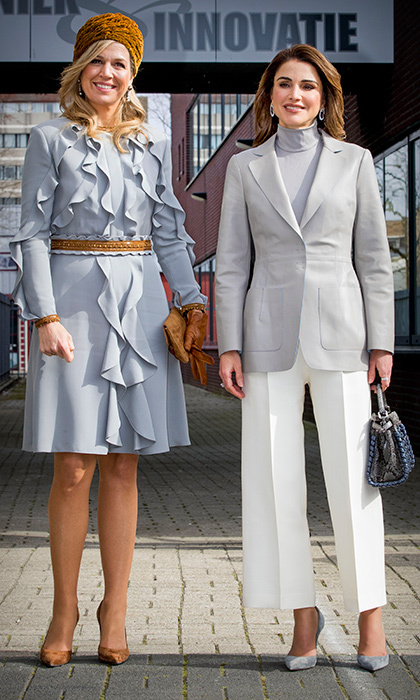 The Dutch Queen wore similar hues as Queen Rania as they visited the ROC Mondriaan technical school on March 21 in The Hague. Queen Maxima wore a pale pastel ruffled dress and one of her signature hats, while Rania wore a grey jacket with coordinating bag and pumps.