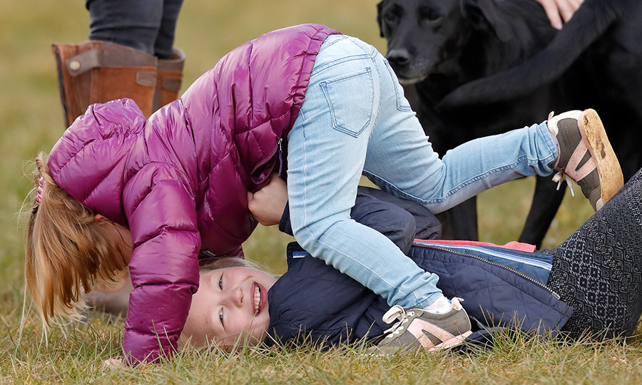 Royal cousins Mia Tindall and Savannah Phillips – both great-granddaughters of Queen Elizabeth – looked like they were having more fun than anyone at Gatcombe Park on March 25 in Stroud, England. 