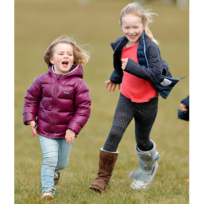 Running after Mia Tindall, not even an injured foot could keep Savannah Phillips from the free-spirited antics at the Gatcombe Horse Trials.