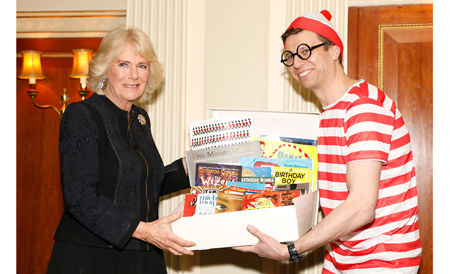 Where's Waldo? Just ask Camilla, the Duchess of Cornwall! The British royal met a fun run participant dressed as the fictional character – who is actually known as 'Wally' in the UK – at a reception to mark The National Literacy Trust's 25th anniversary at Plaisterers' Hall in London.