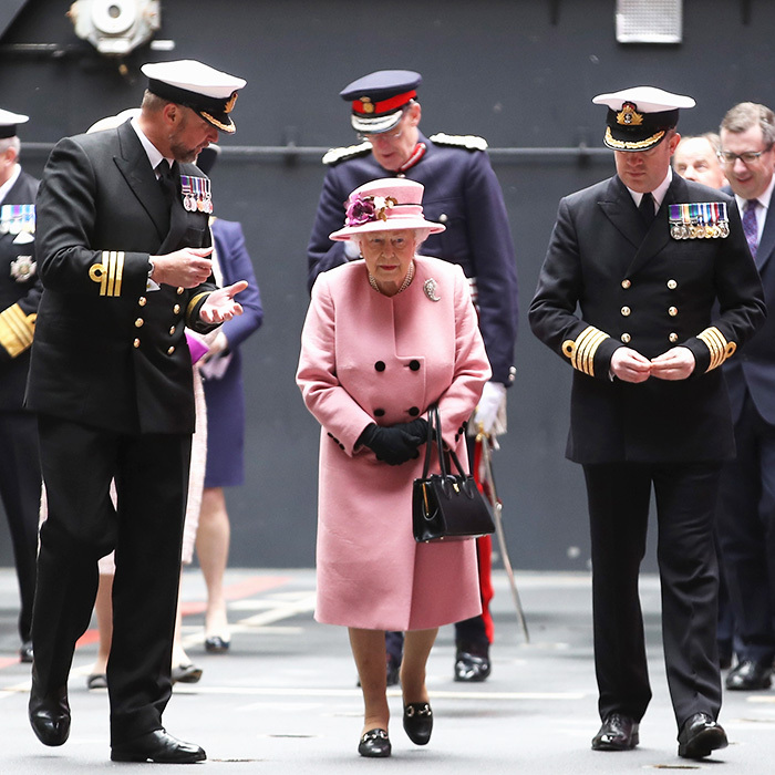 Queen Elizabeth II, 91, was accompanied by Naval officers as she attended the decommissioning ceremony for the amphibious assault ship <I>HMS Ocean</I> on March 27 in Plymouth, England. 