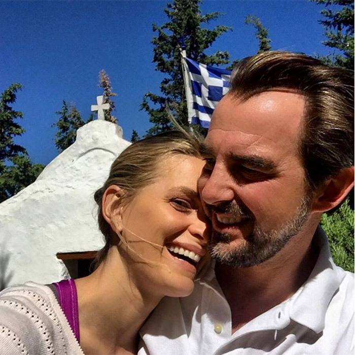 "Princess Tatiana of Greece shared an adorable selfie with husband Prince Nikolaos – @skylightchaser on Instagram – on social media in honor of a very special occasion! ""Xronia Polla from us to you! Celebrating Greek Independence Day  #reasonsilovegreece #athens #naturalandhealthyliving #greece #xroniapolla. Best selfie photographer @skylightchaser,"" she captioned the sunny snap, which was taken in Dionysos.