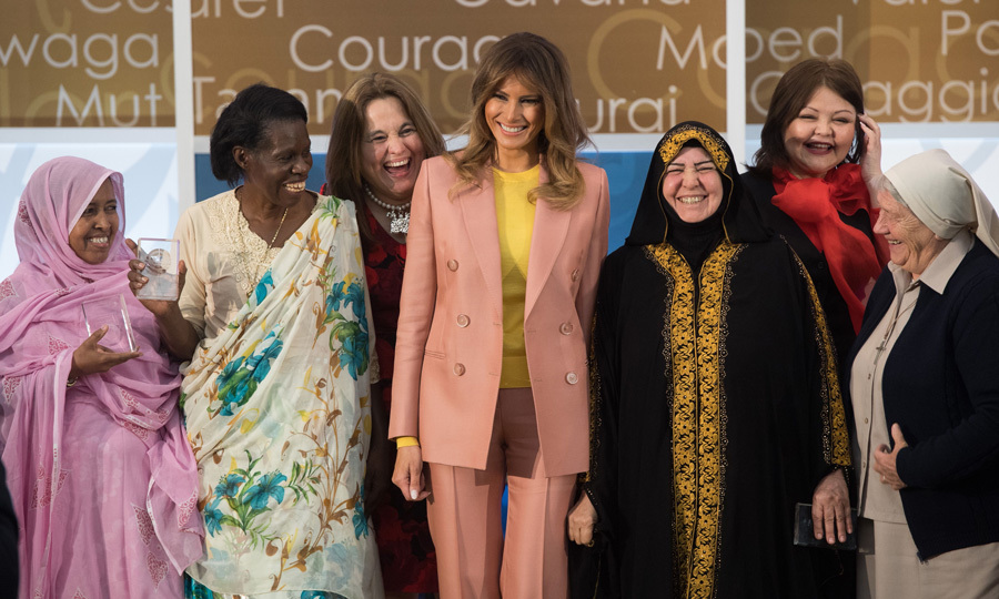 "The first lady looked ready for spring wearing a $4,220 pink Emilio Pucci suit and bright yellow top to present the 2018 International Women of Courage Award on March 23. In a speech at the D.C. event, Melania said, ""As we recognize these incredible women, let us think for a moment about what courage truly is. Courage is the quality most needed in this world, yet it is often the hardest to find. Courage sets apart those who believe in higher calling and those who act on it.  It takes courage not only to see wrong, but strive to right it. Courage is what sets apart the heroes from the rest. It is equal parts bravery and nobility."" 