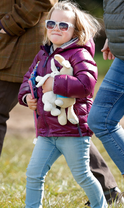 One cool cat with her bunnies! Mia wore a pair of shades and held her stuffed animals close during the Gatcombe Horse Trials on March 25, 2018.