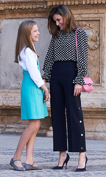 Meanwhile in Mallorca, Queen Letizia of Spain was trendy in polka dots and cropped trousers as she joined the Spanish royal family – including daughter Princess Sofia – at Easter services. King Felipe's wife accessorized the look with a pink shoulder bag.