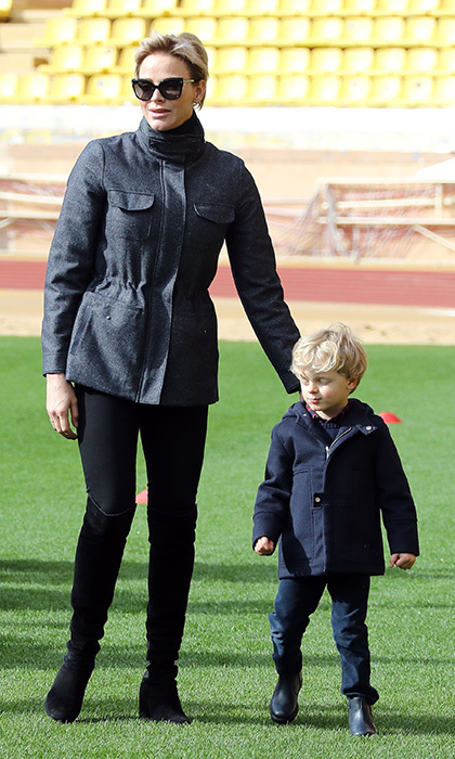 Meanwhile in Monaco, mom-of-two Princess Charlene went casual in a windbreaker and over-the-knee boots with an equally dressed down Prince Jacques, three. Mother and son were attending the Tournoi Sainte Devote International Rugby tournament at the Louis II Stadium in Monaco.