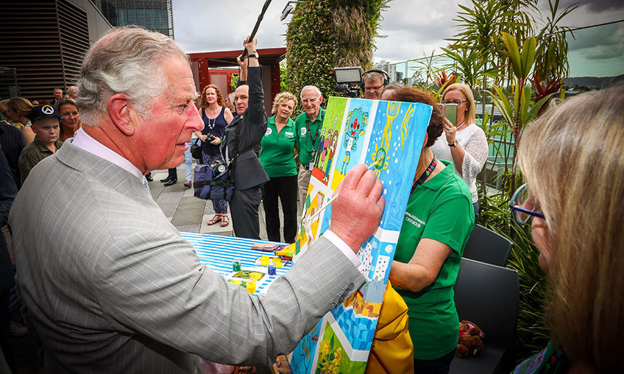 Prince Charles added some finishing touches to a children's painting during his official visit to the Lady Cilento Children's Hospital in Brisbane.