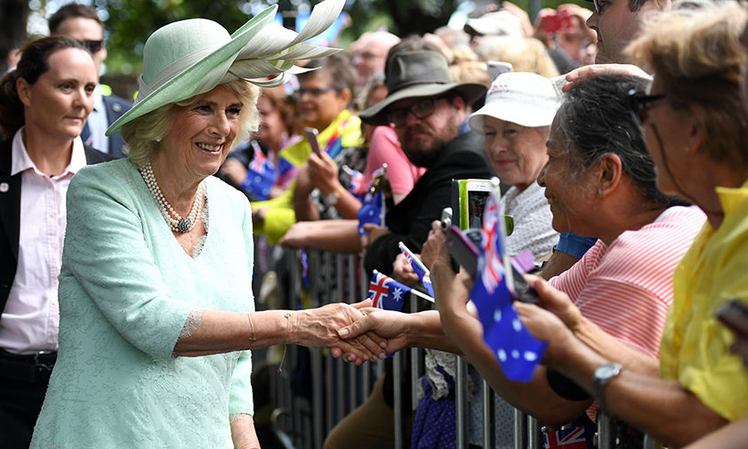 As family patriarch Prince Philip was hospitalized for hip surgery, Prince Charles and Camilla, the Duchess of Cornwall set off on schedule for their seven-day tour of Australia. Here Duchess Camilla is greeted by members of the public in during a visit to Brisbane on April 4.