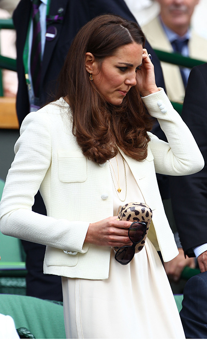 Catherine, Duchess of Cambridge carried a Diane von Furstenberg leopard print clutch as she made her way to the Royal Box during the Wimbledon Tennis Championships at the All England Lawn Tennis and Croquet Club in 2012.