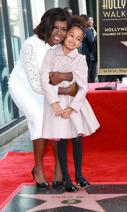 Acclaimed actress Viola Davis shared her special moment with her daughter Genesis Tennon, giving the little girl an embrace at the ceremony in January 2017 .