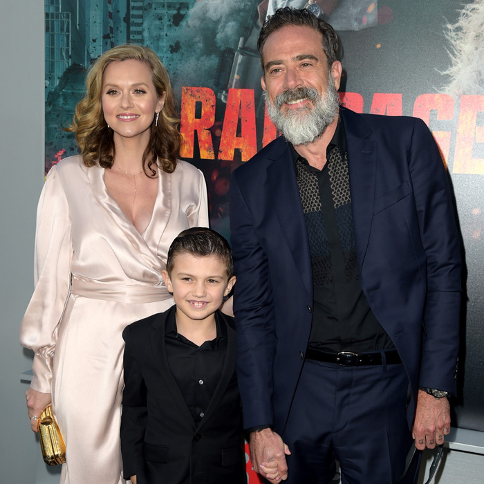"Jeffrey Dean Morgan and Hilarie Burton's eight-year-old son Augustus ""Gus"" was a red carpet natural at the premiere of <i>Rampage</i> in April 2018. The couple's oldest was dapper in a black suit with black shirt and his hair slicked back.