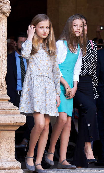 While Leonor wore a floral spring dress and Sofía sported a vibrant turquoise jumper for 2018 Easter church service, the stylish sisters coordinated wearing the same suede Mary Jane flats and wearing their glossy tresses down. The siblings stayed close as they departed the Cathedral-Basilica of Santa María de Palma de Mallorca with their parents and parental grandparents.