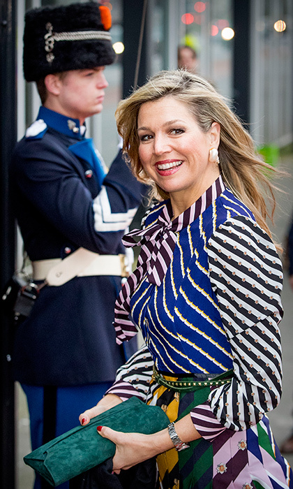 Dutch Queen Maxima flashed a smile as she made her entrance at the Oosterpoort theater for the Kingsday concert on April 9 in Groningen, Netherlands. 