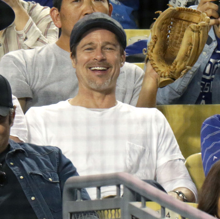 Brad Pitt took that smile to the ballgame! The <i>Money Ball</i> actor went solo to see the Los Angeles Dodgers play.