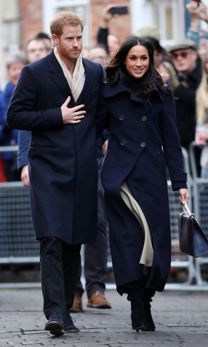 A few days after their engagement announcement, Prince Harry and Meghan Markle made their first official joint visit in Nottingham, UK on December 1, 2017. The two spent the day celebrating World AIDS Day and visiting youth and mentors at the Full Effect Program. The Prince and the actress were met by huge crowds, including royal watchers and press, who came to the city to catch a glimpse of the happy couple. Under her navy blue Mackage coat, Meghan styled a classic black shirt by Wolford, a stylish nude midi skirt by Joseph, and black tall boots. 