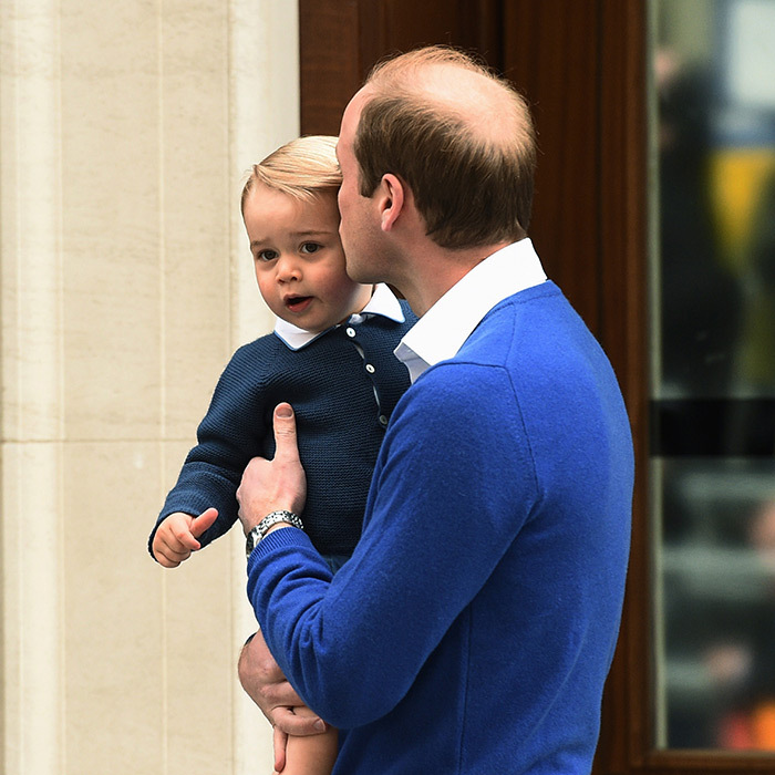 Dressed in a nearly identical outfit as his son, William paused briefly outside the doors to the Lindo Wing, talking to George all the while to reassure the little boy. He then gave his son a tender kiss before heading into the hospital to start their new chapter as a family of four.
