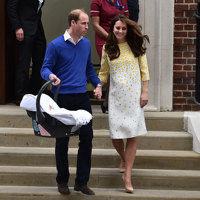 William and Kate – who again chose Jenny Packham for her leaving the hospital look – looked thrilled as they walked down the steps of the Lindo Wing hand in hand with their new baby in tow. 