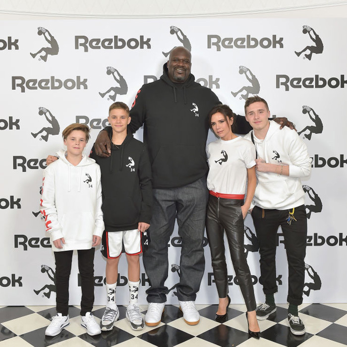 Victoria Beckham and her sons Cruz, Romeo and Brooklyn stood tall next to Shaquille O'Neal at the launch of the designer's collaboration with Reebok in L.A.
