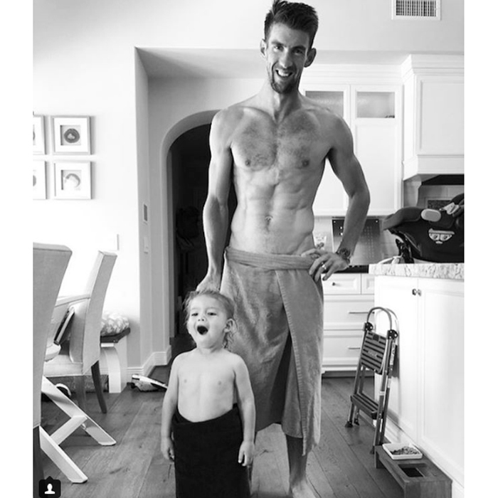 "Michael had his best buddy with him for a swim. The dad-of-two shared the black-and-white photo on his Instagram along with the caption: ""Nothing like an afternoon swim with the little man!! Then he learned how to tie his towel around his waist! #family  @mrs.nicolephelps #bestmommy""
