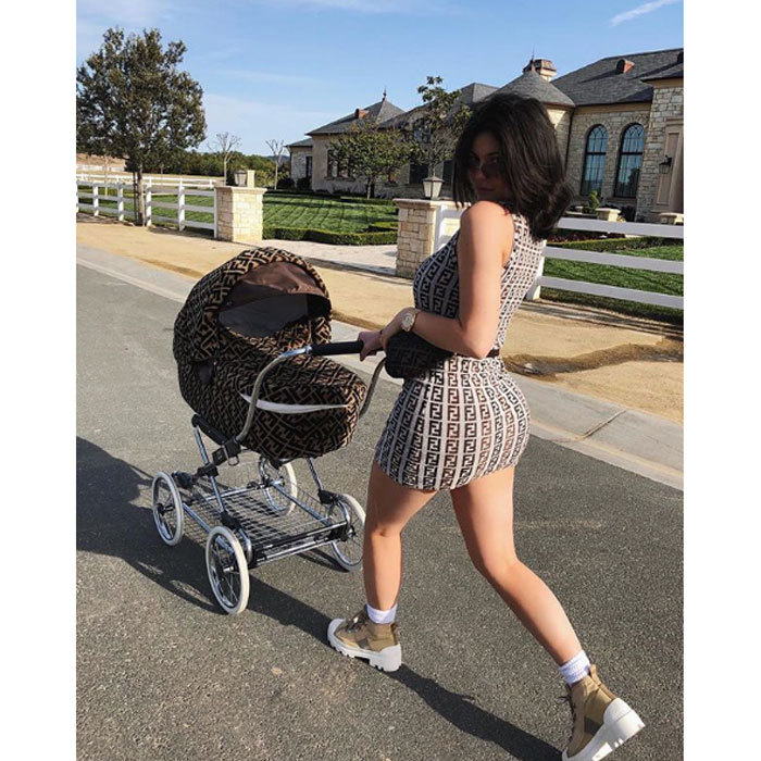 Kylie Jenner didn't give a F(endi) when walking daughter Stormi through her neighborhood. The 20-year-old was outfitted in a mini logo'd mini dress that matched her baby girl's stroller, which is made for order and costs $12,500.