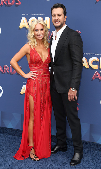 Luke Bryan walked the red carpet with wife Caroline Boyer, who was one of the evening's many ladies in red. 